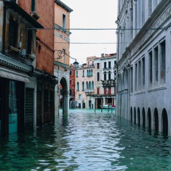 A canal in Venice, Italy. Photo by Nastya Dulhiier on Unsplash.