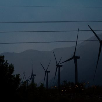 Wind turbines and electricity lines at night